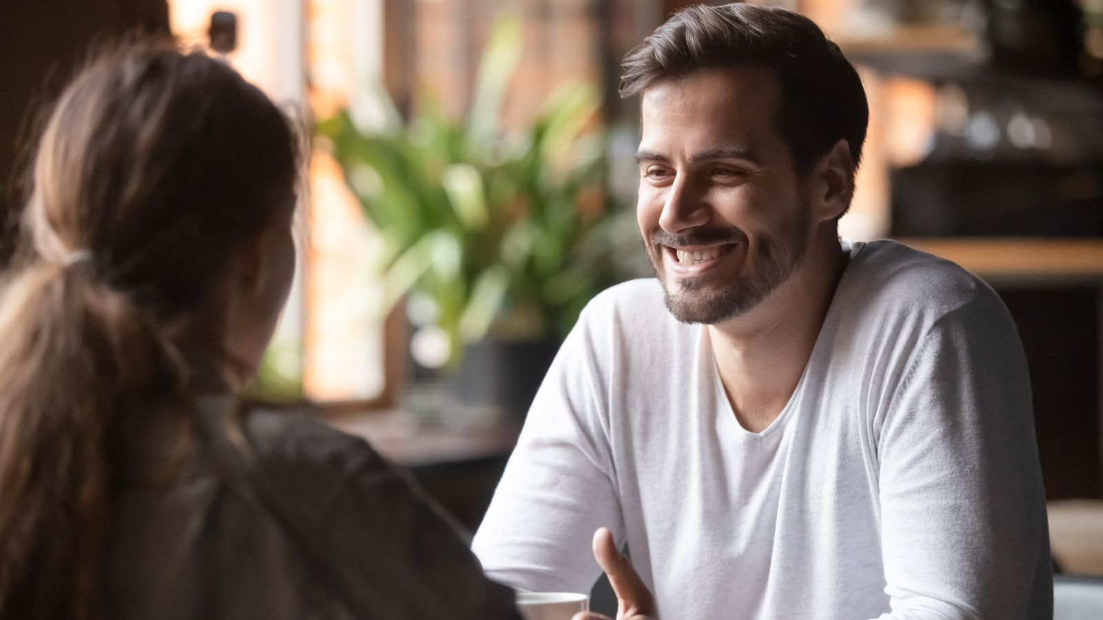 Business owner smiling during a conversation with their accountant