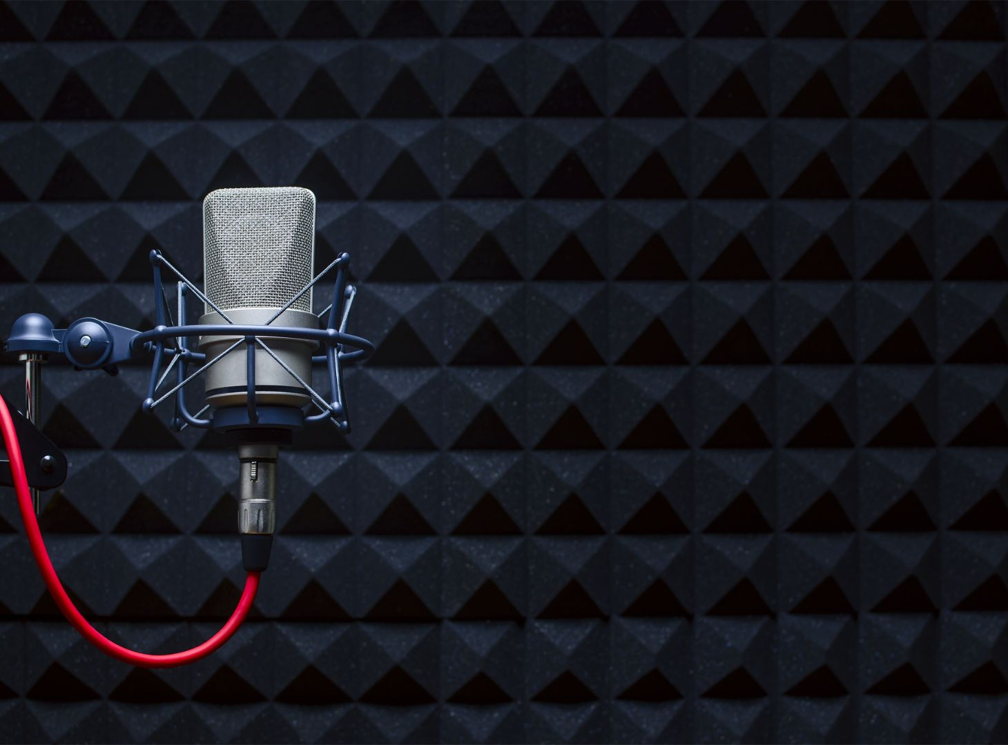 Image of microphone infront of a black background