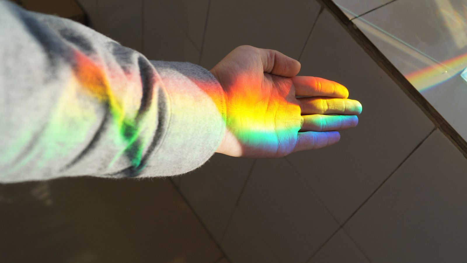 Image of a rainbow on a hand