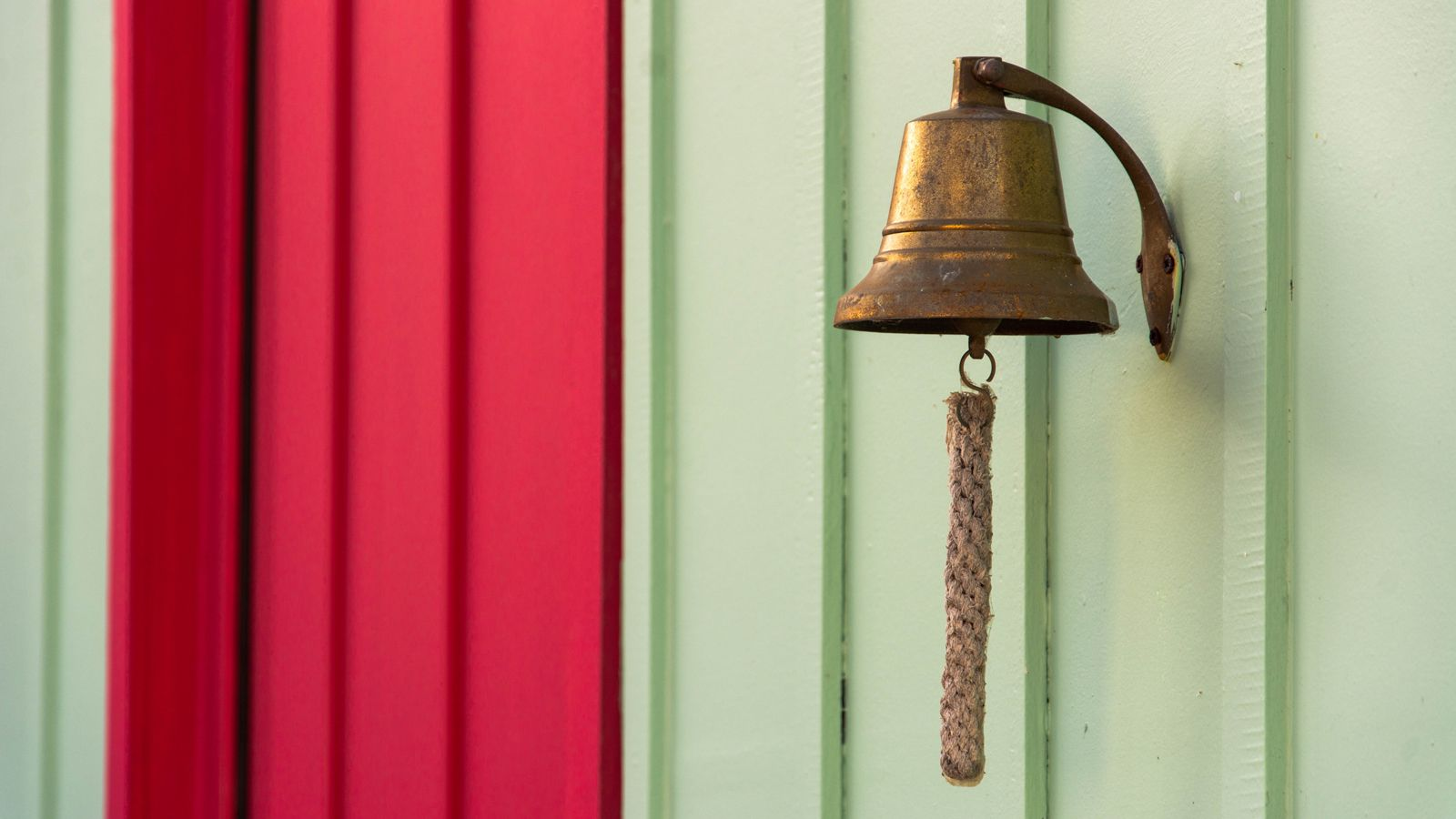 Image of a brass bell on a wall